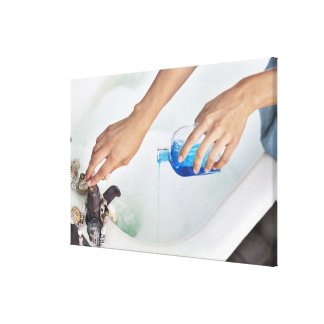 Close-up of a woman's hand pouring aromatherapy canvas print