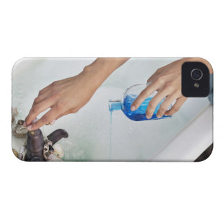 Close-up of a woman's hand pouring aromatherapy iPhone 4 cover