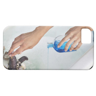 Close-up of a woman's hand pouring aromatherapy iPhone 5 covers