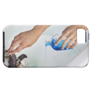 Close-up of a woman's hand pouring aromatherapy tough iPhone 5 case