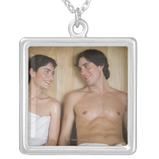 Close-up of a young couple sitting in a sauna silver plated necklace