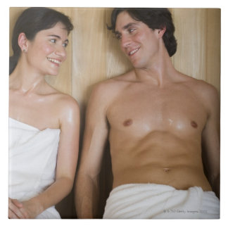 Close-up of a young couple sitting in a sauna tile