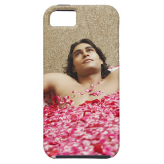 Close-up of a young man lying in a bathtub iPhone 5 cases