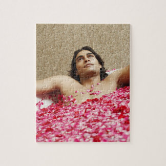 Close-up of a young man lying in a bathtub jigsaw puzzle