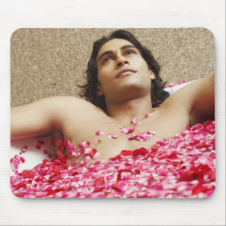 Close-up of a young man lying in a bathtub mouse mat