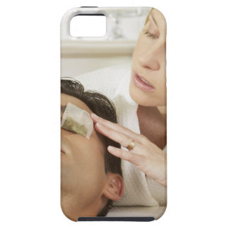 Close-up of a young woman putting teabags over a iPhone 5 cases