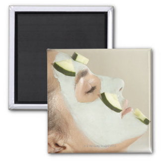 Close-up of a young woman wearing a facial mask square magnet