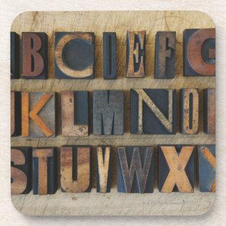 Close up of alphabet on letterpress 2 coaster