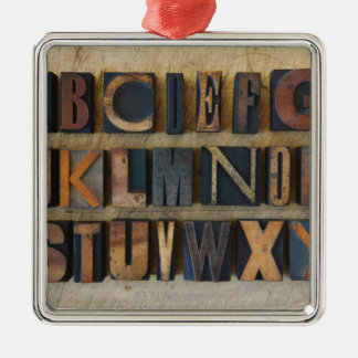 Close up of alphabet on letterpress christmas ornament