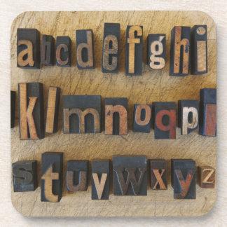 Close up of alphabet on letterpress coaster