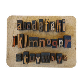 Close up of alphabet on letterpress rectangular photo magnet