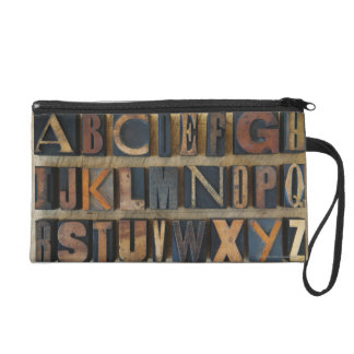 Close up of alphabet on letterpress wristlet