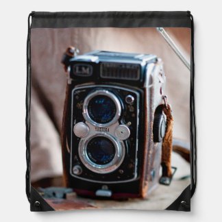 Close-up of an antique camera drawstring bag