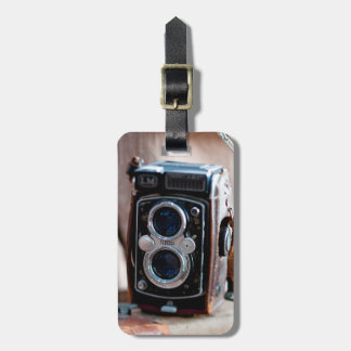 Close-up of an antique camera luggage tag