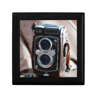 Close-up of an antique camera small square gift box