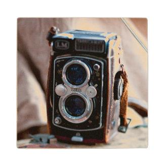 Close-up of an antique camera wood coaster