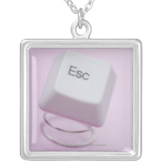 Close-up of an escape key silver plated necklace