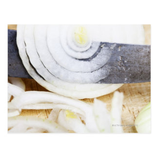 close-up of an onion, being cut into slices postcard