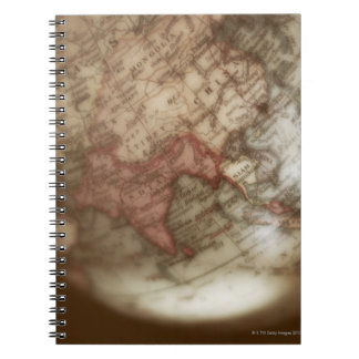 Close up of antique globe 2 notebooks