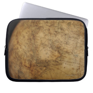 Close up of antique globe 3 laptop sleeve