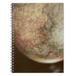 Close-up of antique globe notebooks