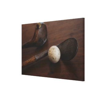 Close up of antique golf clubs and golf ball gallery wrap canvas
