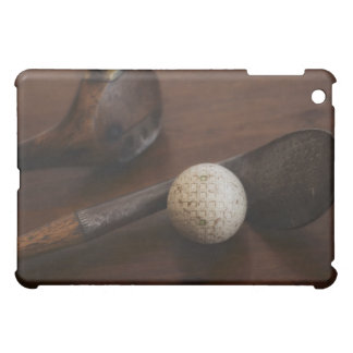 Close up of antique golf clubs and golf ball cover for the iPad mini