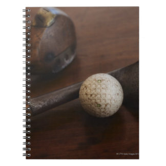 Close up of antique golf clubs and golf ball notebooks
