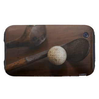 Close up of antique golf clubs and golf ball tough iPhone 3 case