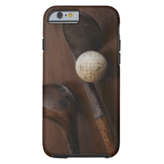 Close up of antique golf clubs and golf ball tough iPhone 6 case