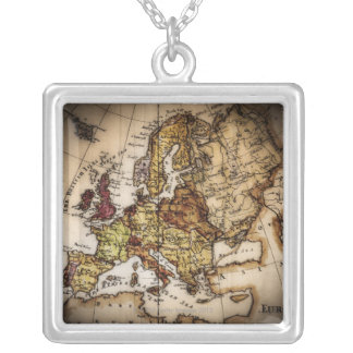 Close up of antique world map 2 silver plated necklace