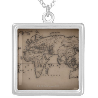 Close up of antique world map 7 silver plated necklace