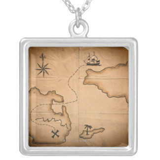 Close up of antique world map with ship route silver plated necklace