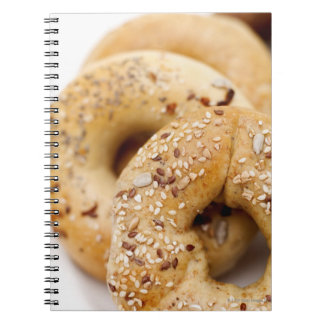 Close-up of assorted bagels on a plate notebooks
