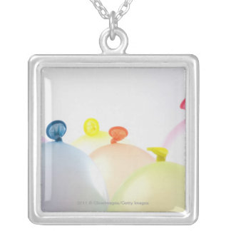 Close-up of balloons silver plated necklace
