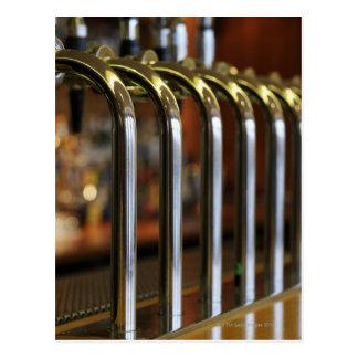 Close-up of bar taps postcard