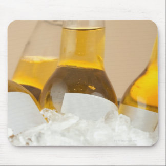Close-up of beer bottles in ice mouse pads