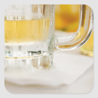 Close up of beer in glass square sticker