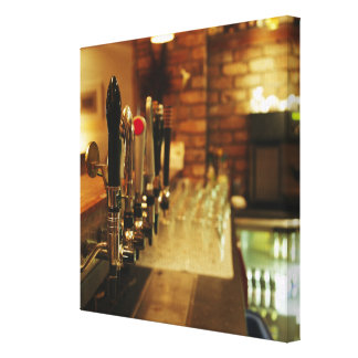Close-up of beer taps in bar 2 gallery wrap canvas