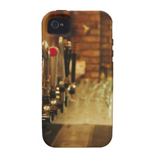 Close-up of beer taps in bar 2 vibe iPhone 4 cover