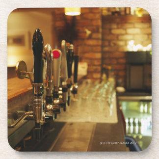 Close-up of beer taps in bar 2 beverage coaster