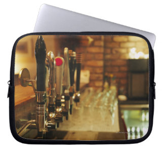 Close-up of beer taps in bar 2 laptop sleeves