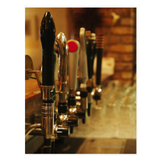Close-up of beer taps in bar 2 postcard