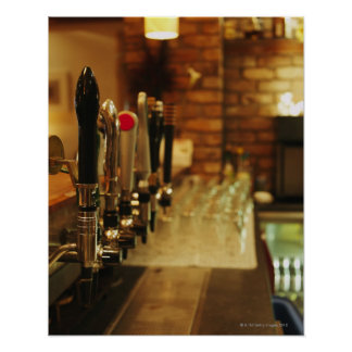 Close-up of beer taps in bar 2 poster