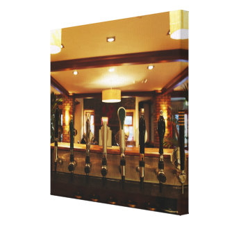 Close-up of beer taps in bar canvas print