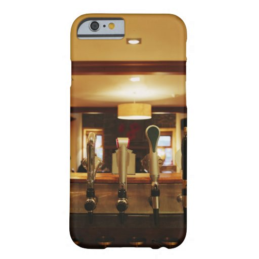 Close-up of beer taps in bar iPhone 6 case