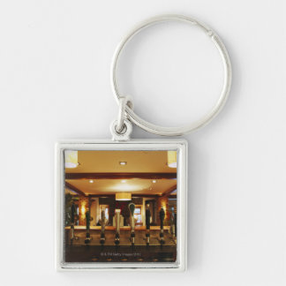 Close-up of beer taps in bar key chain