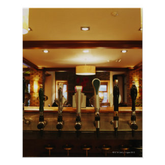 Close-up of beer taps in bar poster