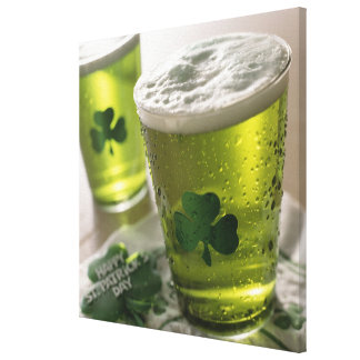 Close up of beverages with shamrocks on glass stretched canvas prints
