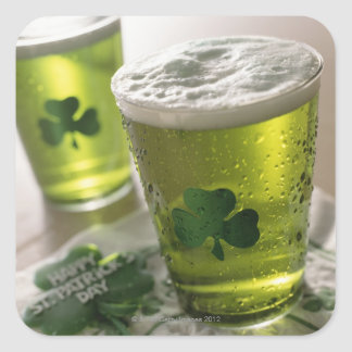Close up of beverages with shamrocks on glass square sticker